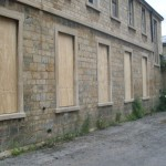 empty property security wooden boarded up building