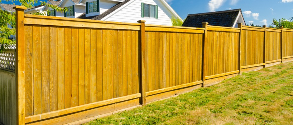 Garden fencing around a home on a sunny day