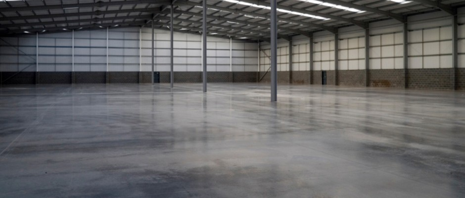 empty and cleaned factory or warehouse space indicating a property clearance service has been used